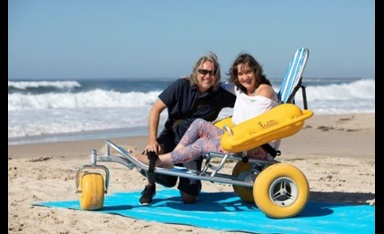 Accessible beach image showing beach wheelchair and matting