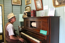 Friends of Bankfoot House President Ron Gillinder playing the vintage pianola