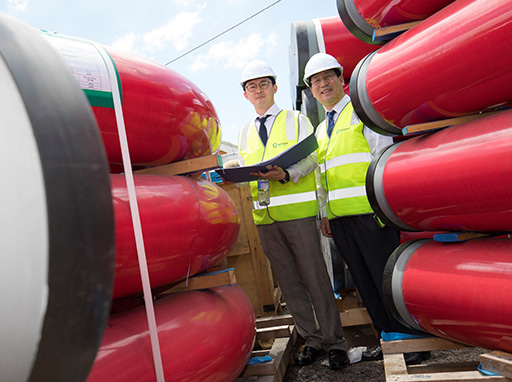 Envac representatives from Korea inspect pipes for the underground waste system