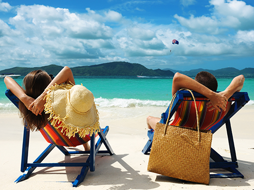 People relaxing on a beach in Phuket