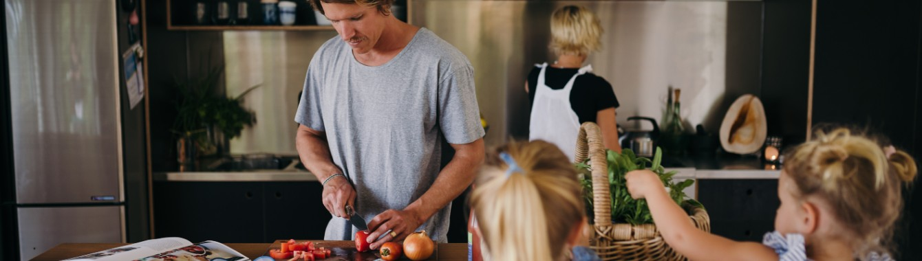 Family in kitchen living a sustainable lifestyle